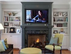 Love the bookshelves and the tile inside the fireplace