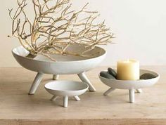 Pedestal bowls are stylish and incredibly adaptable to different rooms and needs.  I love old wooden ones but these modern ceramic ones are great too.