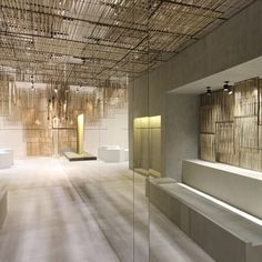 Handcrafted woven bamboo screens are suspended in sections to cover the ceiling and walls of this Isabel Marant boutique in Bangkok by Parisian studio Ciguë. Isabel Marant, Commercial Interiors, Commercial Design, Style At Home, Bamboo House Design, Interior Design Blogs, Bamboo Screening, Architecture Design, Bamboo Architecture