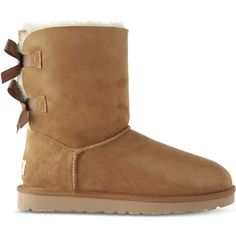 Ugg Ladies Brown Bailey Bow Sheepskin Boots (9.375 RUB) ❤ liked on Polyvore featuring shoes, boots, uggs, sheepskin shoes, brown bow boots, bow boots, shearling lined shoes and ribbon boots