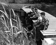Boys fishing off the dock at 4-H Memorial Camp, 1951.
