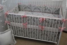 Grey Damask crib bedding with pink trim and ribbon ties