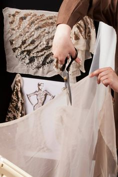 Haute Couture, the making of a dress - fashion atelier; dressmaker at work…
