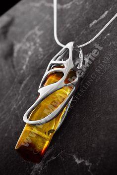 http://www.myamber.net/www/pictures/Image/najwieksze/amber-pendant-57.jpg