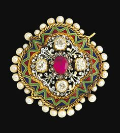 A 19th century gold, diamond and enamel brooch  Designed as a quatrefoil panel with central foiled ruby and rose-cut diamond raised cluster and old brilliant-cut diamond cardinal points on a openwork white and black pique enamel ground within a red, green and blue guilloché enamel crenellated border and seed pearl surround, circa 1890, detachable brooch fitting