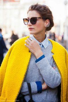 Yellow coat and shades.