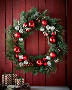 """Wreath made of plastic, Styrofoam, and polyester on a rattan core. 32""""Dia. Imported."""