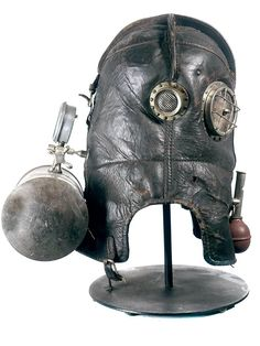 This is the celebrated Vajen-Bader smoke rescue helmet. These full face helmets are very rare and found mostly in museum collections. It's considered the Holy Grail for collectors of early Industrial technology and fire rescue. It is also thought of Steampunk Armor, Gothic Aesthetic, Full Face Helmets, Museum Collection, Cowboy Boots, Smoke, Art Reference, Diving, Masks
