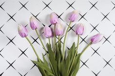 Breath-taking beauty and almost real! Bring home the tulip buds and add an exotic touch to your spaces. #HomeDecor #Flowers #Buds #Lifestyle #BeautifulFlowers #Tulips #DecorAccessories