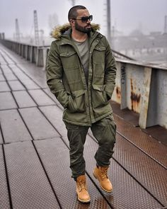 - Fall outfit inspiration with a green parka jacket green t-shirt aviators green cargo pants brown timberlands Green Pants Outfit, Cargo Pants Outfit, Green Cargo Pants, Timberland Outfits Men, Timberland Stiefel Outfit, Timberland Style, Big Men Fashion, Best Mens Fashion, Green Parka Jacket