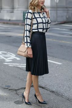 Office Style // Long sleeves top with black pleated skirt.