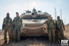 """#FriendsOfTheIDF(FIDF) .... An Israel Defense Forces's tank team from the 401 Armored Corps stand proudly next to their """"Merkava IV"""" tank - Big shout out to the tank crew!"""