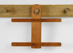 """Shaker Double Hanger  A rare form made to hold multiple garments and be hung on a pegrail.  Constructed entirely of pine with the cross pieces secured to the back by means of screws.  In an old or original dry oxidized surface.  Community unknown.  Circa 1860.  H. 11 1/2"""", w. 12 7/8""""."""