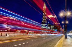 """Night Pulse"", The Shard, London, UK. Image by David Gutierrez Photography, London Photographer. London photographer specialising in architectural, real estate, property and interior photography. http://www.davidgutierrez.co.uk #realestate #property #commercial #architecture #London #Photography #Photographer #Art #UK #City #Urban #Beautiful #Interior #Arts #Cityscape #Travel #Building #River #Bridge #Night #Twilight #Street"