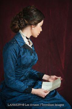 © Lee Avison / Trevillion Images - Victorian-woman-holding-letter