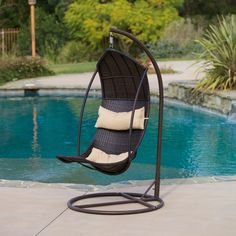 Enjoy your yard with this fun outdoor swinging lounge chair. Built from thick brown meshed wicker, this piece extends to allow the user to lie back in a comfortable lounge position.
