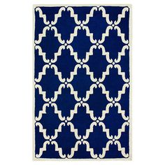 Showcasing a trellis motif in blue, this hand-tufted wool rug is equally at home anchoring your breakfast table or placed in the living room.