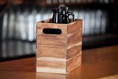 GROWLER CRATE  Carry your locally-brewed suds home safely in the Growler Crate ($40