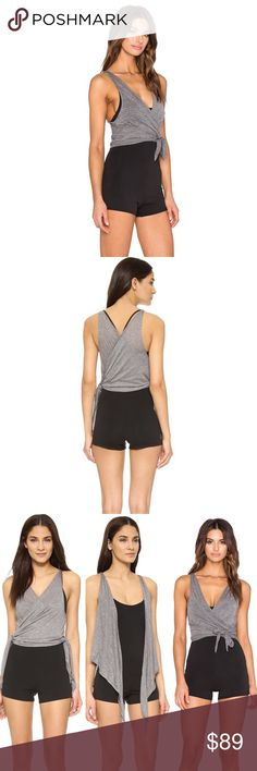Free People movement bodysuit NWT SIze large This is a fun and relaxed bodysuit by free people for their movement collection. This is perfect for those studio workouts, like Pilates or yoga. Features a strapping racerback bodysuit with built in overlay that can be tied multiple ways for versatile looks! Size large and very stretchy material :) NWT Free People Shorts