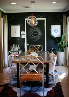 sam of style/swoon's house. mixed chairs.