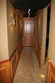 DH Custom Home, home theater in Chesterfield MO. Hallway leading up to the theater