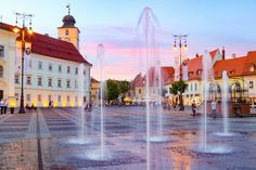 "Sibiu was voted Cultural European Capital in 2007 and named by Forbes as, ""Europe's most idyllic place to live"". Here are 11 things to do in Sibiu. Travel Tours, Nightlife Travel, Tour Around The World, Around The Worlds, Sibiu Romania, Group Tours, Bucharest, Night Life, Countryside"