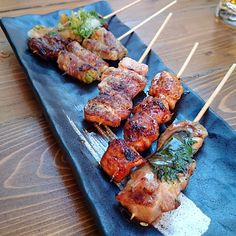 Zakkushi - A cozy Japanese spot with a tapas menu featuring yakitori (charbroiled skewers of meat) plus sake. #Toronto