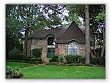 Kingwood home roofed with Teak Owens Corning® Duration® Shingles