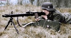 """German machine gunner from the reserve battalion of the division """"Großdeutschland"""" with a light machine gun MG.42 (Nickname : Hitler Buzzsaw) readied for firing from a prone position.  https://www.facebook.com/World-War-Colorisation-790508287736232/timeline/"""