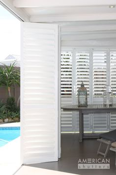 Sophisticated, Elegant, Traditional styled Louvres Shutters that answer our modern needs. These shutters are a perfect addition for any patio area. Outside Shutters, Indoor Shutters, White Shutters, Exterior Shutters, Timber Slats, Timber Deck, American Shutters, Louvered Pergola, Security Shutters