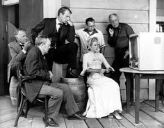 Cast members of High Noon watch the World Series opener between the NY Yankees and the NY Giants on television on a Hollywood movie set on Oct. Gary Cooper, Grace Kelly, Marlene Dietrich, Cary Grant, John Wayne, New York Giants, New York Yankees, Fred Zinnemann, Dina