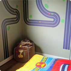 Race track on bedroom wall around bunk beds