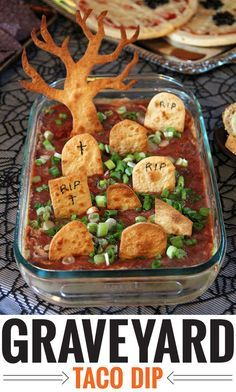 Graveyard Taco Dip Recipe from Chickabug.  Seven layer dip with fewer layers & tortilla tombstones.