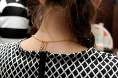 One of the e.l.f. Cosmetics girls wearing our new necklace, with a little eye in the back.