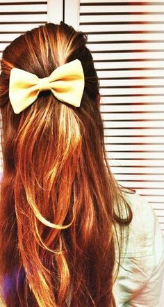 Copper red hair with long layers and cute bow.