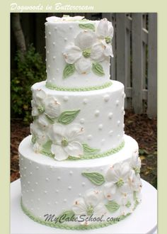 Beautiful buttercream dogwoods make this the perfect cake design for a southern wedding.  Member video tutorial can be found on MyCakeSchool.com!