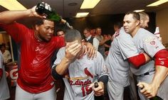 From left to right, St. Louis Cardinals' Victor Marte, Jon Jay, Chris Carpenter and Carlos Beltran celebrate in the locker room after defeating the Atlanta Braves 6-3 in the National League wild card playoff baseball game on Friday, Oct. 5, 2012, in Atlanta