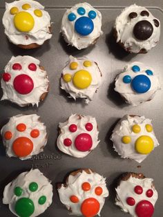 Cupcake design for a pet themed party. Dog and cat lovers from all around would like these. Cupcakes were frosted with white frosting and topped with mini and mega M&Ms.