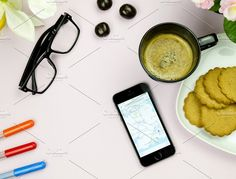 Map on a phone and a cup of coffee by M Comanescu Photography on @creativemarket