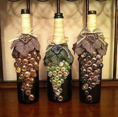 Altered Bottles - use a wine bottle, flat marbles, twine and fabric leaves to create grapes! Wine Bottle Corks, Wine Bottle Crafts, Twine Wine Bottles, Vodka Bottle, Lighted Wine Bottles, Crafts To Make, Diy Crafts, Recycled Crafts, Handmade Crafts