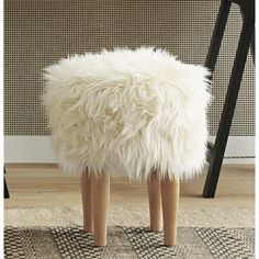 My new Nate Berkus Faux Fur Stool. I want to paint little black hooves on the legs :) Sleepy-sheep bedtime reading foot stool for my bedroom.