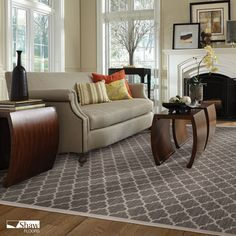 This stunning bound carpet in an arabesque pattern is the perfect foundation for this living room. Make it yours!