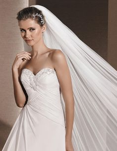 Roele WEDDING DRESSES 2016 A-line dress in draped gauze. Bodice with sweetheart neckline edged with gemstones. Lace-up back.