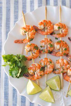 Margarita Shrimp Skewers: 1 lb. shrimp, peeled and deveined 3 Tbsp fresh lime juice 1/2 tsp. fresh lime zest 1 Tbsp olive oil 2 tsp. tequila 2 cloves garlic, minced 3 Tbsp fresh cilantro, chopped 1/4 tsp. sea salt Pinch of cayenne pepper 12 bamboo skewers, soaked