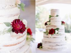 Naked wedding cake with white icing and red flowers.