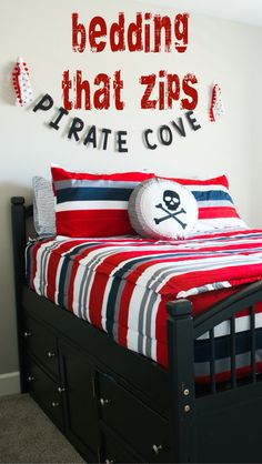 Boys pirate themed bedroom. Perfecf bedding for beds with drawers. Love the red stripes!