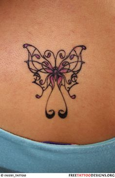 Purple lower back butterfly tattoo