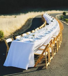 dream wedding dinner - a long winding table out in the fields