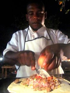 Pizza in Zanzibar's Forodhani Gardens night market. It's an omelet-pizza hybrid that looks absolutely scrumptious!