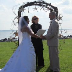 Such a beautiful starfish arch. If you want the best officiant for your Outer Banks, NC, ceremony, contact Rev. Barbara Mulford: myobxofficiant.com/ Starfish, Banks, Arch, Wedding Dresses, Beautiful, Fashion, Moda, Longbow, Bridal Dresses